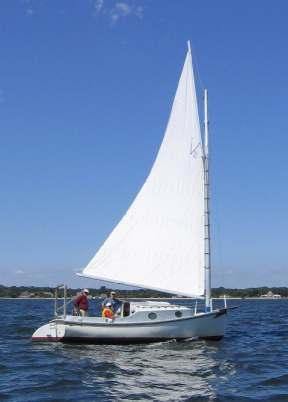 Catboat sailing